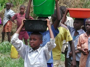 A Ugandan boy carrying water for the family
